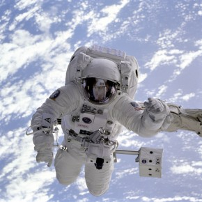Astronaut floating in space above planet earth (NASA)