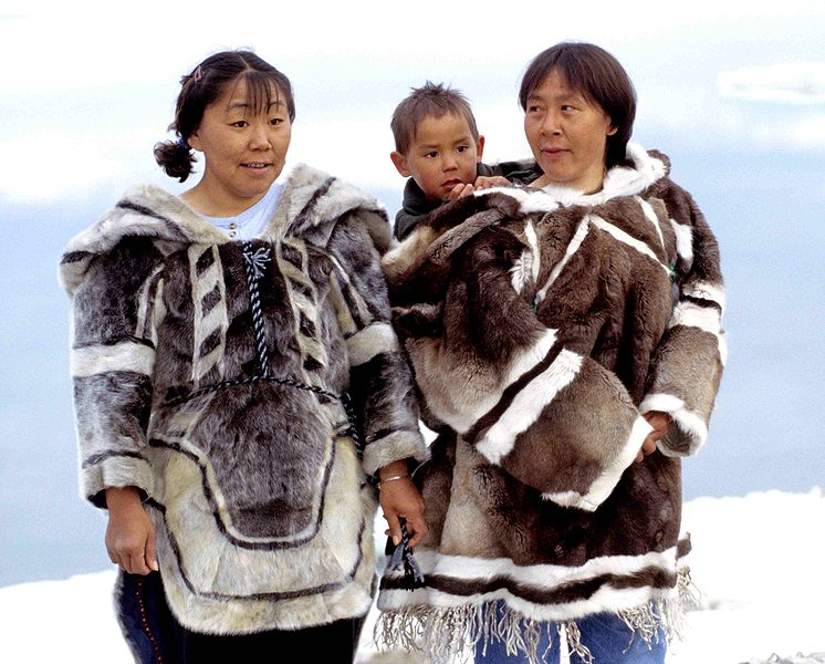 Inuit traditional clothing (left seal, right caribou) photo by Ansgar Walk 1999
