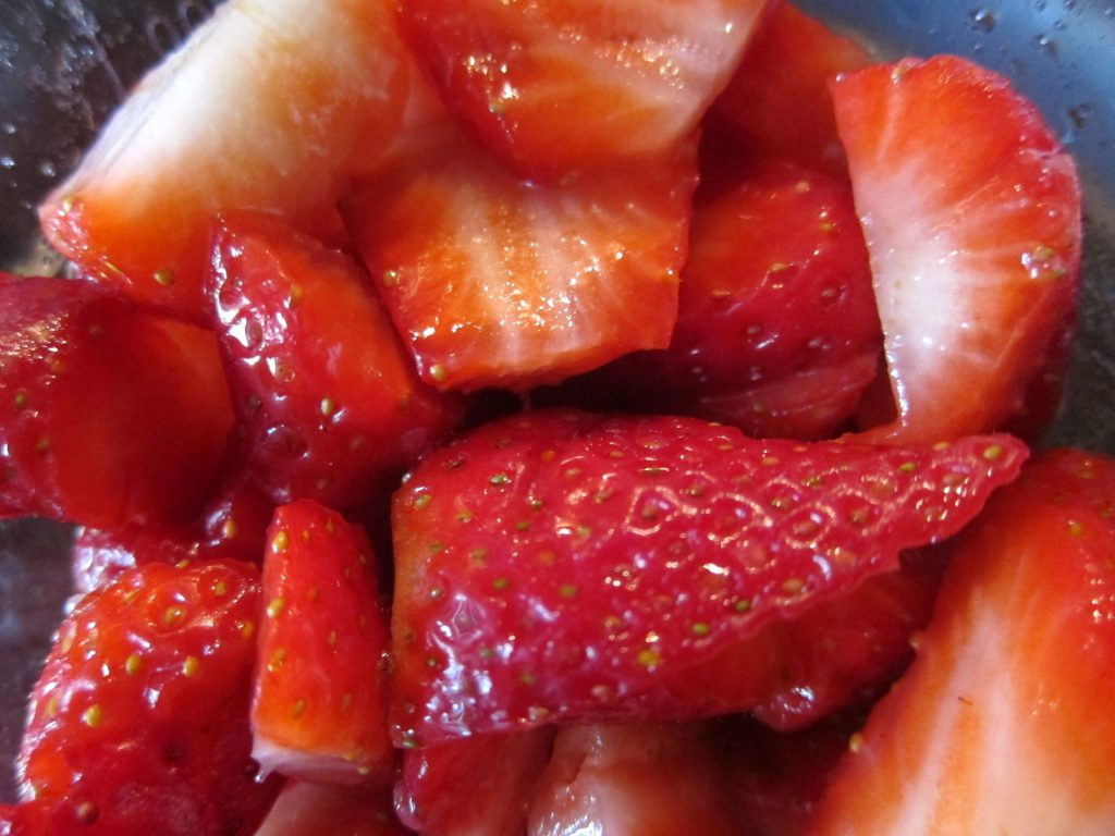 "Macerating strawberries is easy - just chop them up roughly, drizzle over sugar and leave to ""soak"" for about half an hour or more."
