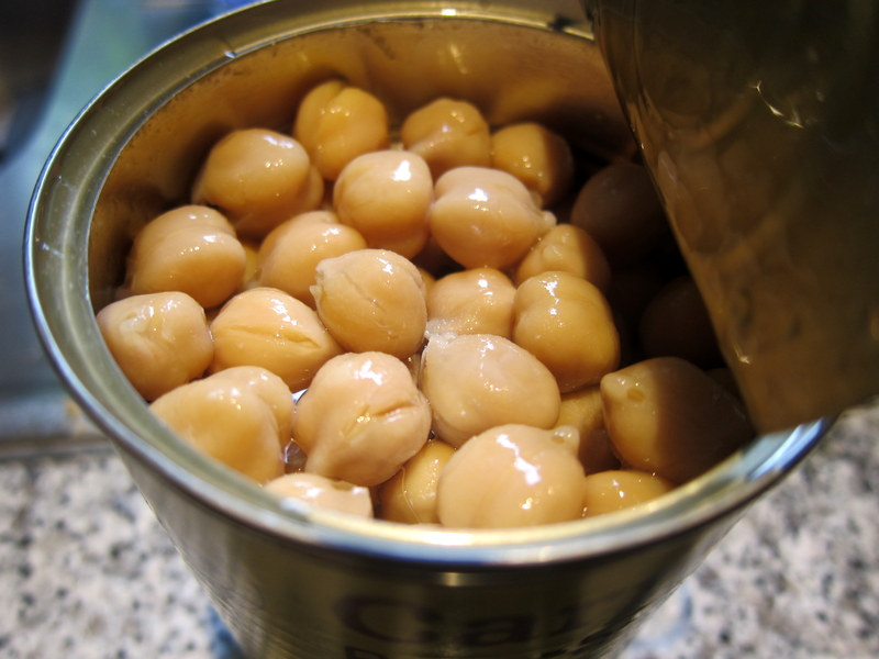 The quick and easy way to aquafaba - open a can of chickpeas and collect the liquid!
